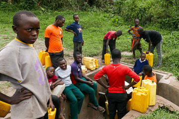 Young people collecting water